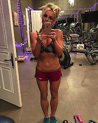 """Britney Spears releases a photo on Instagram with the following caption: """"Staying focused\ud83d\udc59\ud83e\udd8b\ud83c\udf3a\ud83c\udf80"""". Photo Credit: Instagram *** No USA Distribution *** For Editorial Use Only *** Not to be Published in Books or Photo Books ***  Please note: Fees charged by the agency are for the agency's services only, and do not, nor are they intended to, convey to the user any ownership of Copyright or License in the material. The agency does not claim any ownership including but not limited to Copyright or License in the attached material. By publishing this material you expressly agree to indemnify and to hold the agency and its directors, shareholders and employees harmless from any loss, claims, damages, demands, expenses (including legal fees), or any causes of action or allegation against the agency arising out of or connected in any way with publication of the material."""