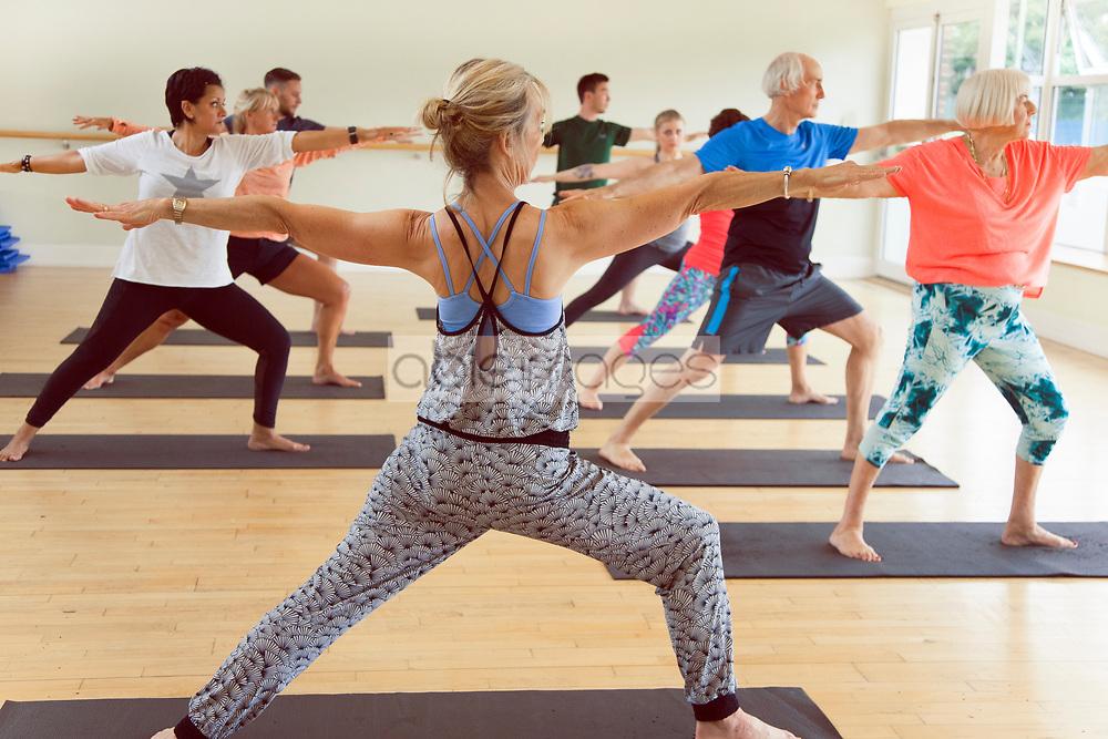 People Practicing Yoga at Yoga Studio