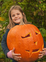 Girl with halloween lantern, smiling, portrait