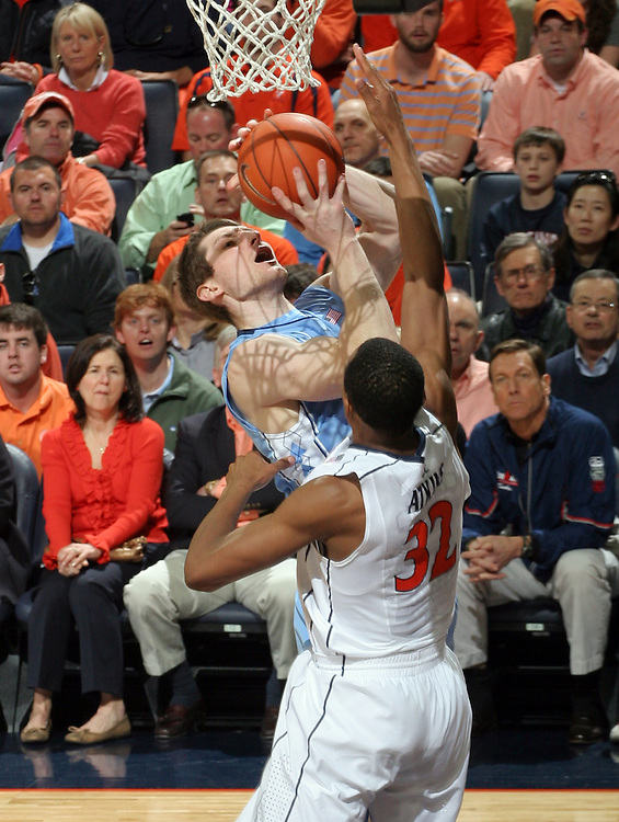 North Carolina Tar Heels forward Tyler Zeller (44) shoots over Virginia Cavaliers forward Darion Atkins (32) during the game in Charlottesville, Va. North Carolina defeated Virginia 54-51.