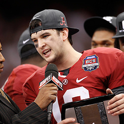 Jan 9, 2012; New Orleans, LA, USA; Alabama Crimson Tide quarterback A.J. McCarron talks with ESPN  broadcaster John Sauners after defeating the LSU Tigers 21-0 in the 2012 BCS National Championship game at the Mercedes-Benz Superdome.  Mandatory Credit: Derick E. Hingle-US PRESSWIRE