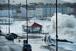 © London News Pictures. Aberystwyth, Wales. 03/01/2014. A 5.6m high springtide and gale force south westerly winds bring  massive weaves pounding against the promenade and harbour at Aberystwyth on the west wales  coast.  The entire promenade was  closed to traffic because of fears for safety. Over 20 severe warnings have been issued for flooding in England and Wales, with the weather set to worsen over the next 24 hours, Across much off the south and west coast. Photo credit: Keith Morris/LNP