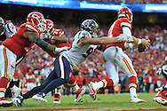 KANSAS CITY, MO - OCTOBER 20:  Defensive end J.J. Watt #99 of the Houston Texans sacks quarterback Alex Smith #11 of the Kansas City Chiefs during the second half on October 20, 2013 at Arrowhead Stadium in Kansas City, Missouri.  Kansas City won 17-16. (Photo by Peter Aiken/Getty Images) *** Local Caption *** J.J. Watt;Alex Smith