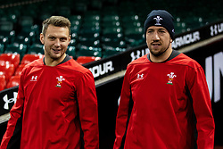 Dan Biggar of Wales with team-mate Justin Tipuric<br /> <br /> Photographer Simon King/Replay Images<br /> <br /> Six Nations Round 1 - Wales v Italy -  Captains Run - Friday 31st January 2020 - Principality Stadium - Cardiff<br /> <br /> World Copyright © Replay Images . All rights reserved. info@replayimages.co.uk - http://replayimages.co.uk