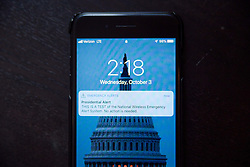 October 3, 2018 - Philadelphia, Pennsylvania, United States - A notification is seen on a smartphone as FEMA tests the new ''Presidential Alert'' functionality of the Wireless Emergency Alerts system, October 3, 2018 in Philadelphia. The new alert, which is accompanied by a loud sound and from which cellular subscribers cannot opt-out, is designed to be used by the President to communicate to the public during a national emergency. (Credit Image: © Michael Candelori/NurPhoto/ZUMA Press)