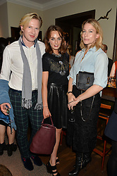 Left to right, HENRY CONWAY, LADY VIOLET MANNERS and AMY WILLIAMS at a private view of the Beulah Winter Autumn Winter collection entitled 'Chrysalis' held at The South Kensington Club, London SW7 on 24th September 2015.