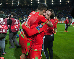ZENICA, BOSNIA & HERZEGOVINA - Saturday, October 10, 2015: Wales Joe Allen and Neil Taylor celebrate after securing a place at next years Euro Championships after the Bosnia & Herzegovina vs Wales match at the Stadion Bilino Polje during the UEFA Euro 2016 qualifying Group B match. (Pic by Peter Powell/Propaganda)