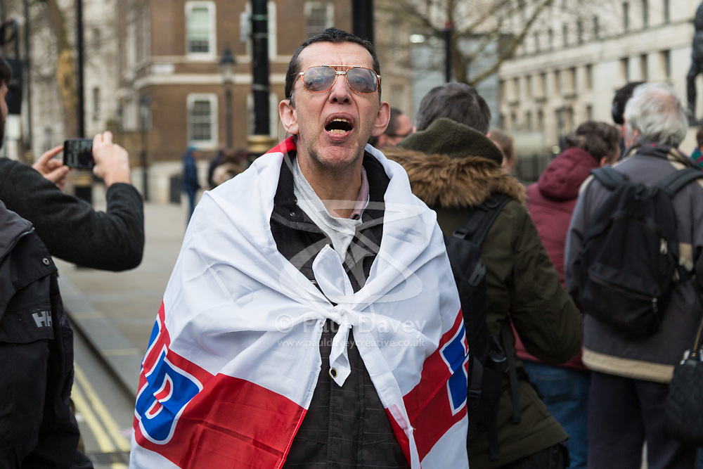 PLACE, January 14 2018. A few dozen protesters from 'The People's Charter' group demonstrate outside Downing Street demanding that the Brexit referendum result is respected following calls for a second referendum. PICTURED: A man wearing an England flag yells at a cyclist who had just had his EU flag stolen from him. © Paul Davey