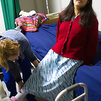 Marie Elena flexes her leg for therapy after her hip replacement operation. Oregon orthopedic doctors and support staff helped hundreds of Peruvian children in Coya, Peru performing corrective surgeries and therapy to improve their quality of life.