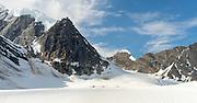 Aircraft unload tourists on the Ruth Glacier, below Denali (Mt. McKinley), Denali National Park, Alaska.