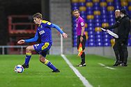 AFC Wimbledon manager Glyn Hodges watches AFC Wimbledon defender Steve Seddon (42) dribbling during the EFL Sky Bet League 1 match between AFC Wimbledon and Bristol Rovers at Plough Lane, London, United Kingdom on 5 December 2020.