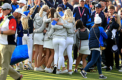 Team Europe wives and girlfriends celebrate on day three of the Ryder Cup at Le Golf National, Saint-Quentin-en-Yvelines, Paris.