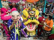 20 SEPTEMBER 2015 - SARIKA, NAKHON NAYOK, THAILAND: Lion dancers greet a statue of Ganesha at the Ganesh festival at Shri Utthayan Ganesha Temple in Sarika, Nakhon Nayok. Ganesh Chaturthi, also known as Vinayaka Chaturthi, is a Hindu festival dedicated to Lord Ganesh. Ganesh is the patron of arts and sciences, the deity of intellect and wisdom -- identified by his elephant head. The holiday is celebrated for 10 days. Wat Utthaya Ganesh in Nakhon Nayok province, is a Buddhist temple that venerates Ganesh, who is popular with Thai Buddhists. The temple draws both Buddhists and Hindus and celebrates the Ganesh holiday a week ahead of most other places.    PHOTO BY JACK KURTZ