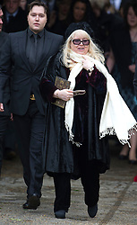 © London News Pictures. 08/06/2012. Thame, UK.   Dwina Gibb, wife of Robin Gibb leaving the family home on her way to St Mary's Church in Thame, Oxfordshire for the funeral of Robin Gibb on June 8, 2012. Robin Gibb died on May 20, 2012 aged 62 following a long battle against cancer. Photo credit: Ben Cawthra/LNP