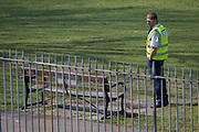 On the first day of the Easter Bank Holiday weekend, and at the end of the second week of lockdown restrictions by the UK government, wardens have started patrolling the parks across the borough in an attempt to stop the flouting of lockdown restrictions such as in Ruskin Park, a public green space in the borough of Lambeth, on 10th April 2020, in London, England.