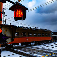 The fan favorite winter stove train of the Tsugaru Railways pulls out of the Kanagi station on the way on it's scenic route of the tundra-like plains of the Tsugaru peninsula.