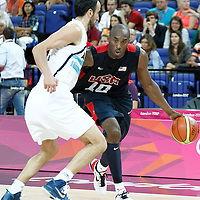 10 August 2012: USA Kobe Bryant drives past Manu Ginobili during 109-80 Team USA victory over Team Argentina, during the men's basketball semi-finals, at the North Greenwich Arena, in London, Great Britain.
