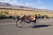Sebastiaan Bowier rijdt op de trainingsfiets op een weg bij Battle Mountain, Nevada (USA). Bowier is met het Human Power Team Delft en Amsterdam (HPT) in Amerika om het snelheidsrecord op de fiets te breken. Dat staat nu op 133 km/h.<br /> <br /> Sebastiaan Bowier is riding his training bike at the desert near Battle Mountain, NV. Bowier is with the Human Power Team Delft and Amsterdam to set a new world record cycling. The world record is now 133 km/h.