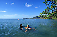 Swimming on a Koh Chang island's beach