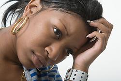 Studio portrait of a teenage girl looking unhappy,