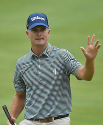 July 15, 2018 - Silvis, Illinois, U.S. - SILVIS, IL - JULY 15:  Chris Streelman acknowledge the applause on the #1 green after sinking a birdie putt during the final round of the John Deere Classic on July 15, 2018, at TPC Deere Run, Silvis, IL.  (Photo by Keith Gillett/Icon Sportswire) (Credit Image: © Keith Gillett/Icon SMI via ZUMA Press)