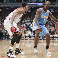 08 November 2010: Chicago Bulls' point guard #1 Derrick Rose defends against Denver Nuggets' point guard #1 Chauncey Billups during the Chicago Bulls 94-92 victory over the Denver Nuggets at the United Center, in Chicago, Illinois, USA.