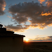 Silhouette of dovecote by sunset at Otero de Sariegos