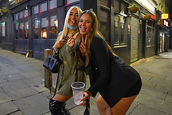 © Licensed to London News Pictures. 16/04/2021. Liverpool, UK. Revellers pose for a photograph as they enjoy the first weekend in Liverpool city centre after lockdown restrictions were eased. Photo credit:  Ioannis Alexopoulos/LNP