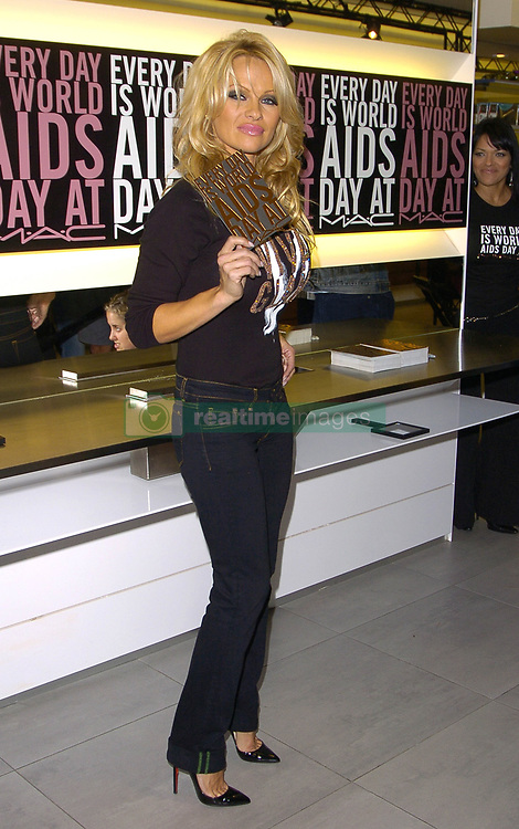Nov. 30, 2005 - Hollywood, California, U.S. - K45946DL.PAMELA REMINDS US TO DO YOUR PART THIS WORLD AIDS DAY AND BUY A M*A*C GALM LIPSTICK, M*A*C STORE, WEST HOLLYWOOD CA.11-30-05.  -   2005.IMAGE: PAMELA ANDERSON(Credit Image: © Dave Longendyke/ZUMA Wire)