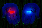 Two hands, one with a glowing red pill and the other with a glowing blue pill, in front of matrix stream of code.Black light