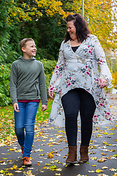 Son Alfie, 10, walks with his mother Claire Tickle who suffered from lipoedema, a hereditary disease which caused massive swelling to her legs is well on the road to recovery following nine operations to correct the condition. Eastleigh, Hampshire, November 04 2018.