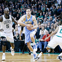 10 February 2013: Denver Nuggets small forward Danilo Gallinari (8) drives past Boston Celtics power forward Kevin Garnett (5) and Boston Celtics point guard Avery Bradley (0) during the Boston Celtics 118-114 3OT victory over the Denver Nuggets at the TD Garden, Boston, Massachusetts, USA.