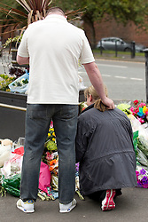 © Licensed to London News Pictures. 29/06/2012. Oldham , UK . The parents of two year old Jamie Heaton , Michelle and Ken, visit the scene where dozens of tributes have been laid in his memory . Jamie Heaton was killed in a large explosion , believed to be caused by gas , which brought down several houses in Shaw , Oldham , on the 26th June . Photo credit : Joel Goodman/LNP
