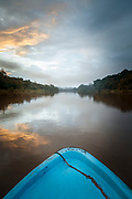 Landscape with a rainforest on the bank of the San Juan River seen from a boat, El Castillo, Rio San Juan Department, Nicaragua