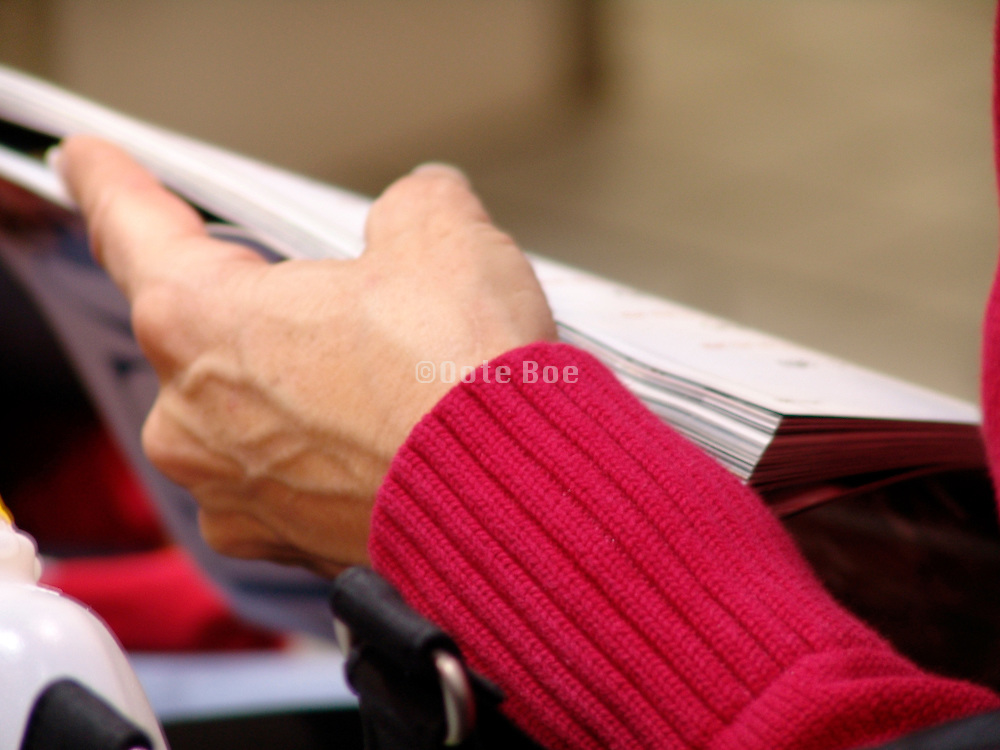 Close up of a person reading a magazine.