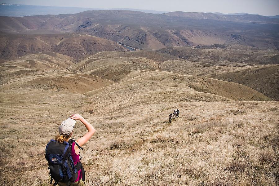 A hiker enjoys the open views from the dry hills of Umtanum Ridge, Umtanum Creek Recreation Area near Yakima, Washington.