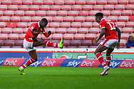 Mamadou Thiam of Barnsley (26) scores a goal and celebrates with Dimitri Cavaré of Barnsley (12) to make the score 2-0 during the EFL Sky Bet League 1 match between Barnsley and Charlton Athletic at Oakwell, Barnsley, England on 29 December 2018.