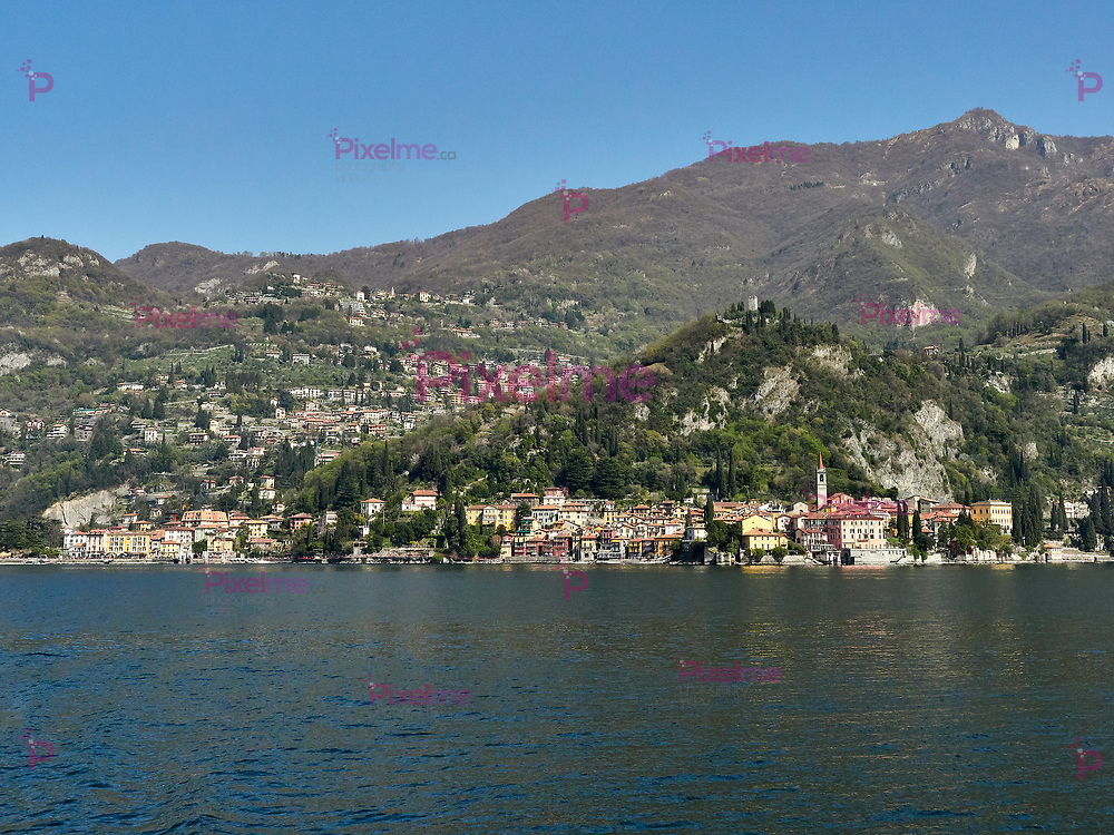 Varenna, Italy  March 30 2019 Far Frontal Lanscape view of  Varenna Town and its surroundings at Lake Como Italy from Ferry with Bellagio as destination