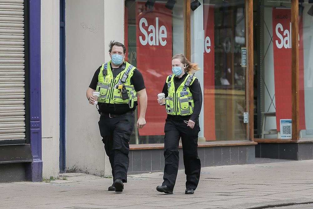 10th March, 2021. Cheltenham, England. Mermbers of the police walking through the town centre wearing a mask.