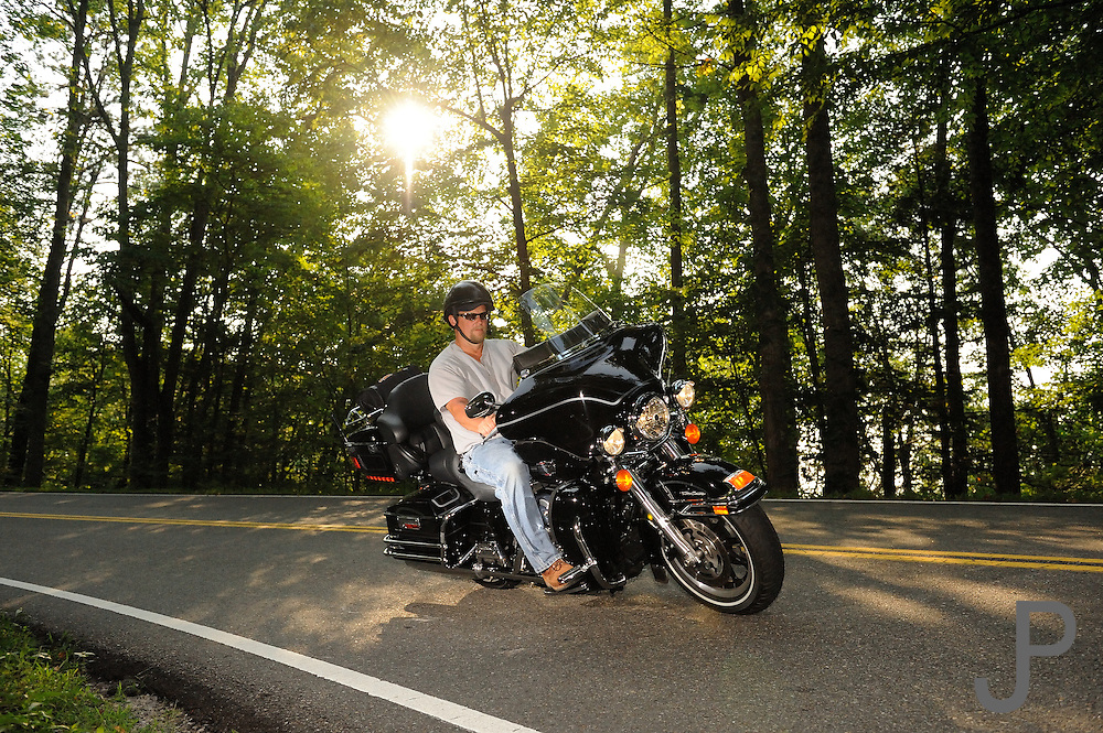 """Motorcycle riding along the """"Tail of the Drago"""" Highway 129 along the Tennessee/North Carolina border. No model release."""