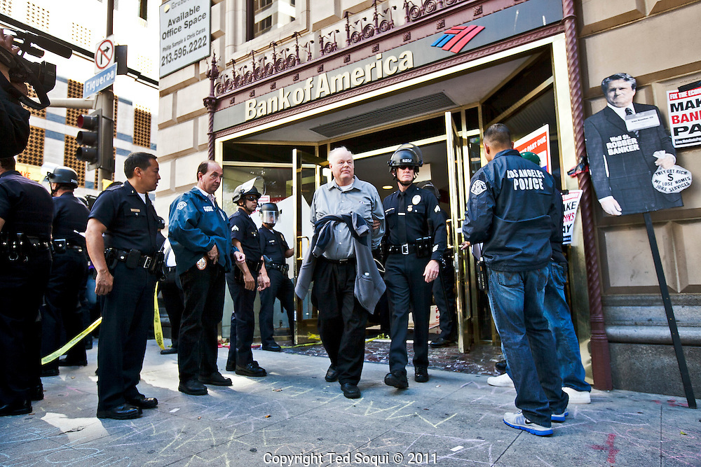 Thousands of Occupy LA protesters march in to the financial district of Los Angeles. The march stopped at several banks including Bank of America on 7th and Figueroa, where several protesters were arrested.