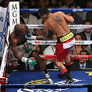 LAS VEGAS, NV - SEPTEMBER 13: Floyd Mayweather Jr. (L) leans back in a neutral corner as Marcos Maidana punches during their WBC/WBA welterweight title fight at the MGM Grand Garden Arena on September 13, 2014 in Las Vegas, Nevada. (Photo by Alex Menendez/Getty Images) *** Local Caption *** Floyd Mayweather Jr; Marcos Maidana