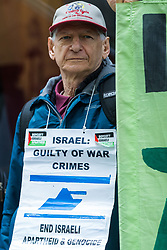 London, UK. 28th May, 2021. An activist from the International Jewish Anti-Zionist Network takes part in a protest by Palestine Action outside the UK headquarters of Elbit Systems, an Israel-based company developing technologies used for military applications including drones, precision guidance, surveillance and intruder-detection systems. The activists were protesting against Elbit's presence in the UK and against British arms sales to and support for Israel.