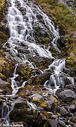 Water in Killen Creek tumbles over basalt rocks as in comes down off the ridge beside Mt Adams