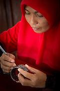 Woman cleaning bracelet, Kraton of Yogyakarta, Yogyakarta, Yogyakarta Special Region, Java, Indonesia, Southeast Asia