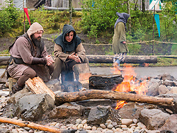 Pictured: Duncarron Medieval Village Opening. Carron Valley Forest, Lanarkshire, 18 May 2019. In authentic Scottish weather, The Clanranald Trust opens a full-scale replica of an early Medieval Fortified Village typical of a Scottish Clan Chief's residence. The open air museum includes traditional buildings such as round houses, a great hall, and tower. The event features music bands and traditional dance.<br /> Sally Anderson | EdinburghElitemedia.co.uk
