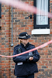 © Licensed to London News Pictures. 24/11/2015. London, UK. Police officers investigate a crime scene in Holloway, north London on Tuesday, 24 November 2015 after a 17-year-old boy stabbed to death on York Close. Photo credit: Tolga Akmen/LNP