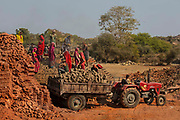 Manual labour at work on the brickworks on the main highway on 20th January 2018, Gogunda, outside the city of Udaipur, India.