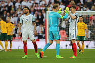 Joe Hart of England congratulating John Stones of England during the FIFA World Cup Qualifier group stage match between England and Lithuania at Wembley Stadium, London, England on 26 March 2017. Photo by Matthew Redman.