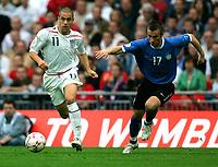 Photo: Tom Dulat.<br /> England v Estonia. UEFA European Championships Qualifying. 13/10/2007.<br /> Enar Jaager of Estonia and Joe Cole of England with the ball.